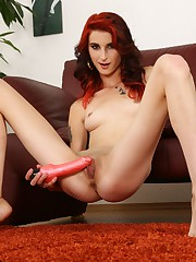 Sexy redhead fills their way pussy with a big dildo