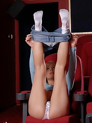 Cute blonde film critic gets horny in the theatre