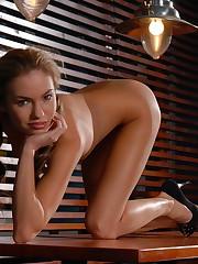Sexy Viki strip teases on a hardwood table