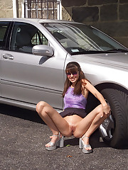 Angelina Stripping & Posing By a Car - 7/7/2006